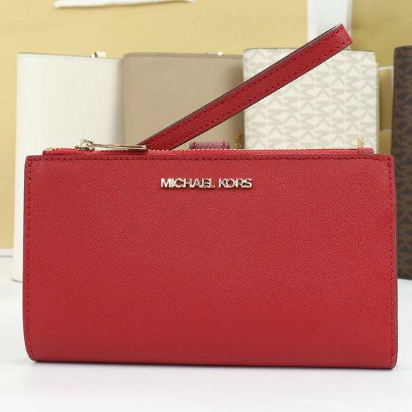 Michael Kors Handbags - Jet Set Travel Double Zip Wristlet